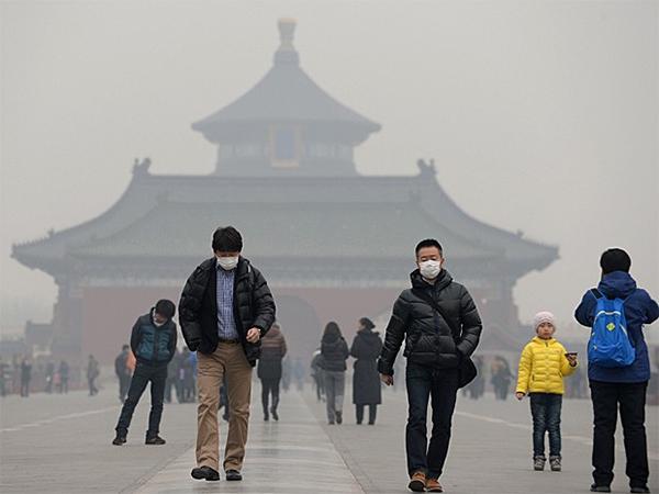 Pessoas expostas a poluição na China